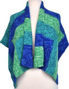 Bauhaus-sjal. Stort, løst sjal i   fra samme firma som Miss Grace. Let at strikke. Godt til store størrelser. Pinde 5.
