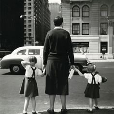 Vivian Maier. Looking in to portraits from behind the subject and came across this. I love the obliviousness of the three subjects. Timing would have been a key factor here, capturing a moving car also.