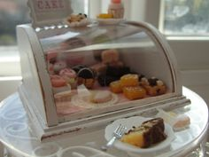 Miniature bakery counter display filled with cupcakes, brownies, cookies and more