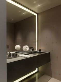 Bathrooms- loving the light strip around the floor to ceiling mirror