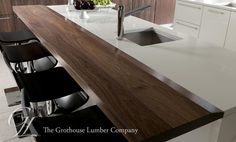 Walnut with Sapwood wood countertop, and a Custom Chamfer on the top of one long edge, all other edges to be slightly eased (hand sanded), Our Durata® permanent finish in satin. Design by John Troxell, Director of Design, Wood-Mode. https://www.glumber.com/image-library/custom-walnut-wood-counters-in-leola-pennsylvania/