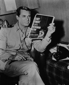 Cary Grant reading an article about himself (and Deborah Kerr)