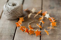Orange peel star garland. Jute string and dried orange peel cut in stars.