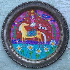 Folk art on a vintage tray.