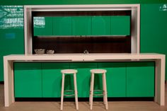 AVANI Kitchens | the white island retracts for more room + all appliances are hidden | 21 of the coolest home products on display at the Interior Design Show 2014 | Toronto Life
