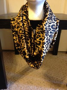 Don't forget your very own leopard print infinity scarf   Made from 100% polyester fabric   Approximately 5 feet all the way around and 10  inches wide  Made in smoke free home  Handmade   Machine wash cold  Do not bleach   Air dry only   Cool iron if needed   All shipping on s...