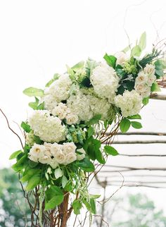 Floral ceremony arch captured by Katie Stoops Photography