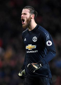 David De Gea of Manchester United celebrates his side's second goal during the Premier League match between Manchester United and Stoke City at Old. Man Utd Fc, American Football League, Manchester United Players, Stoke City, Premier League Matches, Man United, Goalkeeper, Football Players, Role Models
