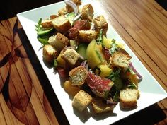 Panzanella Bread Salad - This salad is filled with veggies, tomatoes and croutons, creating a perfect balance of crunch.