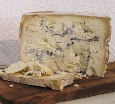 """Blu di Bufala is one of our most delicious blues (or, maybe we should say, """"blus"""").  It has a high fat content (as rich as Half-and-Half) and is chock full of blue veining.  The makers call this cheese """"punchy and profound, with a finish that won't quit.""""  We concur.  And, in case you were envisioning Buffalo Bill when you thought about this cheese, change your tune.  The milk comes from water buffalos - not the ones on our nickels.  Pair with pears for a little bit of heaven."""