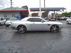widebody 2009 Dodge Challenger R/T. fitted with 26-inch Asanti wheels (AF 144) in the rear and 24-inch wheels in front. 5 star brushed silver grey