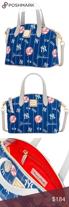 "Dooney & Bourke New York Yankees Navy Satchel Xbod RARE! SOLD OUT Dooney & Bourke New York Yankees Navy Team Color Nylon Ruby Satchel Crossbody Brand New with Tags. Looking for a stylish way to show your New York Yankees spirit? Look no further than this Team Color Ruby satchel from Dooney & Bourke 100% Nylon Body; 100% Cotton Lining; 100% Leather Strap/Accents Two interior slip pockets Inside key hook Cell phone pocket Measures approximately 6.75"" x 4.25"" x 9""  Contrast color bottom…"