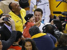 Golden State Warriors guard Stephen Curry holds his daughter Riley after Game 5 of the Western Conference finals.  Tony Avelar, AP