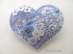Felt Heart Pin / Crazy Quilt Style- Use in art therapy and have stuff that is pertinent to the situation-grief-forgiveness-etc. like pieces of clothing, jewelry, etc from a deceased loved one, rebirth/new hope/heart after tragedy? Beaded Embroidery, Hand Embroidery, Embroidery Designs, Crazy Quilting, Fabric Hearts, Heart Crafts, Felt Brooch, Felt Hearts, Button Crafts