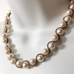 "Vintage Pearl & Gold Necklace A must have for the sophisticated lady! This amazing vintage necklace features luminous pearls intersecting with braided gold chain. Lobster claw closure. 19"" long. Fashion jewelry Jewelry Necklaces"