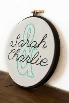 I chose a font, traced onto tissue paper, and embroidered onto some cheap white on white print fabric.  Loved the look.  Would make a terrific baby or wedding gift for anyone.~G