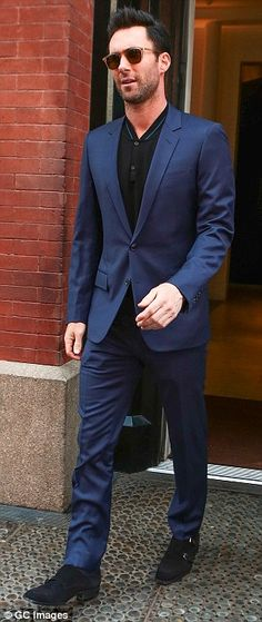 Suave: He strutted out in a slick blue suit in New York on Monday...