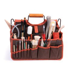 """The Xiem Art Bag is designed for potters, artists and students who need an organized, easy-access, and breathable solution to ceramic tool storage. Actual size is 16"""" x 9"""" x 12"""". It makes a great gift"""