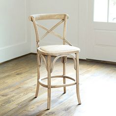 "Constance Counter Stool | $219 | Reminiscent of a classic Thonet bentwood chair from the mid 1800s, our Constance Counter Stool has a contoured, steam-bent ""X"" back that cradles you for surprising comfort. The hand woven rattan seat adds texture and charm."