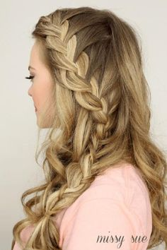 This cascading braid is a really beautiful prom hairstyle. Don't be afraid, all you need to know is how to french braid and you can get this soft look yourself.