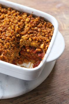 Delicious Moroccan Chickpea Bake, made with a combination of hummus, tagine, and spiced chickpeas. Vegan + Gluten Free