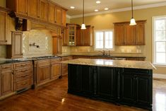 Google Image Result for http://www.timberlandcabinets.com/powerpanel/modules/products/html/uploads/images/1307127342Custom_Cabinets_Glazed_Distressed_Black_Kitchen_Island_Mantel_Hood_4.jpg