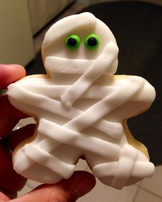 Mummy Cookies - put that gingerbread man cookie cutter to work a  little early this year.