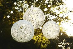 White twine balls - could add lights and can spray paint any color.  DIY Wedding Detail Inspiration!