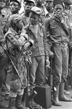 Child soldiers smoking, Angola. 1976