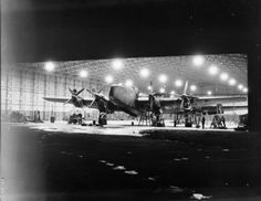 Handley Page Halifax B Mark III Series of No. 1663 Heavy Conversion Unit undergo maintenance at night in a Type hangar at Rufforth, Yorkshire. Air Force Bomber, Handley Page Halifax, Vintage Airplanes, Dog Fighting, Ww2 Aircraft, Royal Air Force, Historical Pictures, World War Ii, Wwii