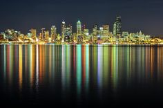 http://fineartamerica.com/featured/seattle-skyline-at-night-hai-huu-thanh-nguyen.html  What captured my attention are the bright colors reflecting on the water from the bright lights of the city. The night picture enhances the bustle and electricity of the city.  Hai Huu Thanh Nguyen - Seattle Skyline At Night Fine Art Print