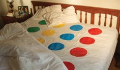 This is not a game... But since it is a Twister game board bed sheet I couldn't help but add this to my funny adult party ideas...