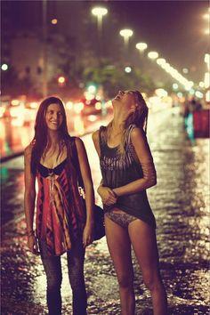 @jean snyder  it's us :) Laughing in the rain rain bokeh city lights friends outdoors street girls
