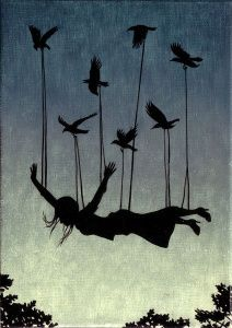woman in siloutte flying with birds