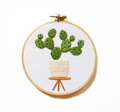 Prickly Pear in Modern Planter Hoop Art - Hand Stitched Modern Embroidery Art by SarahKBenning on Etsy https://www.etsy.com/listing/236352927/prickly-pear-in-modern-planter-hoop-art