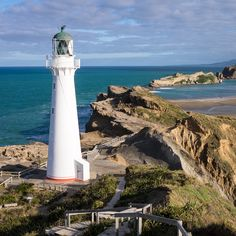 Lamppost on the coast, Castlepoint, New Zealand . Itinerary Planner, Travel Planner, New Zealand Travel, Trip Planning, Wonders Of The World, Lighthouse, Coastal, Bell Rock Lighthouse, Light House