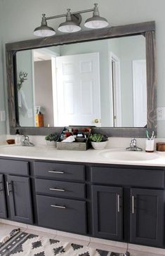 DIY Rustic Wood Mirror Frame Just a few weeks ago we finished our master bathroom makeover on a tiny Bathroom Mirror Design, Small Bathroom, Bathroom Mirror Makeover, Cabinet Makeover, Framed Bathroom Mirrors, Bathroom Vanities, Gold Bathroom, Paint Bathroom Cabinets, Bathroom Lights Over Mirror