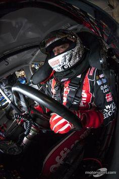 Tony Stewart waits in his car during practice at Kansas