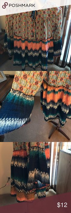 Beautiful BoHo Flowing Tunic This boho style, empress waist top is very pretty and colorful. Has a slight high/low detail and bell 3/4 sleeves. New w/tags from a clean smoke free home. Fig and Flowers Tops Tunics
