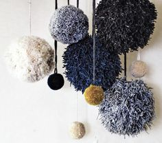 wool pom poms - would make a beautiful installation