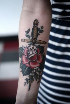 I've wanted thid tattoo for a while and i'll finally get it in 2 months! This dagger through a rose tattoo will be a great first tattoo.