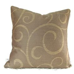 Warm cocoa brown with subtle gold spirals. This 16 inch cover would look great on a white or off-white chair or bundled with other earth tone pillows. Zipper back for easy removal; zipper is hidden under flap. Back of pillow is coordinating fabric. Slight sheen, silky feeling. Spot cleaning recommended.   Here are the details:   *Best fit on 16 x 16 insert  *Smoke-free studio  *Corners are slightly rounded for professional fit and appearance.  *All seams are reinforced, overlocked or…