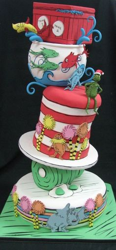 Dr. Seuss Cake @neatorama withc characters from The Cat in the Hat, One Fish - Two Fish, Green Eggs and Ham, Horton Hears a Who, The Lorax, and How the Grinch Stole Christmas