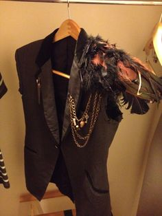 Tux jacket, cut off sleeves, add shoulder pad and feather, add chains and accents, witch doctor outfit