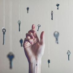 Small key hole wrist tattoo with matching background, Austin Tott - 'Tiny Tattoos'