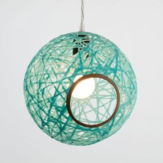 Using resin would around cylinders, Marcus Papay creates colorful, modern lamps made from wood with a contemporary shade.