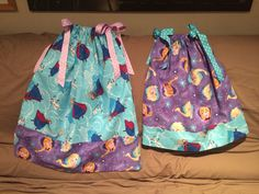 Frozen print pillowcase dresses for child and toddler. Made by Arthur Peanut.