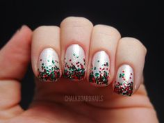 Glitter polish and sequins Christmas nail art design. Fill your nails with silver glitter polish and cap it off with a sequins inspired French tip. It looks absolutely gorgeous and unique.