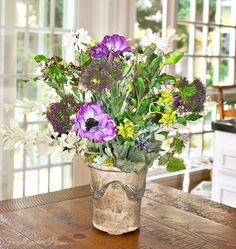 Finally, start a French country sensation with our exuberant purple anemone and field flower arrangement. Presented in a vintage French pottery pot, ...