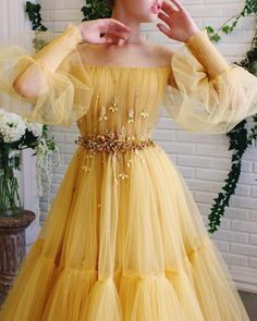 Details - Yellow bumblebee dress color - Tulle dress fabric - Embroidered crystal and leaves on waist - A-line gown with long sleeves and waist definition - For special occasions Prom Dresses Long With Sleeves, Ball Dresses, Ball Gowns, Yellow Prom Dresses, Yellow Gown, Long Yellow Dress, Disney Prom Dresses, Elegant Dresses For Women, Pretty Dresses